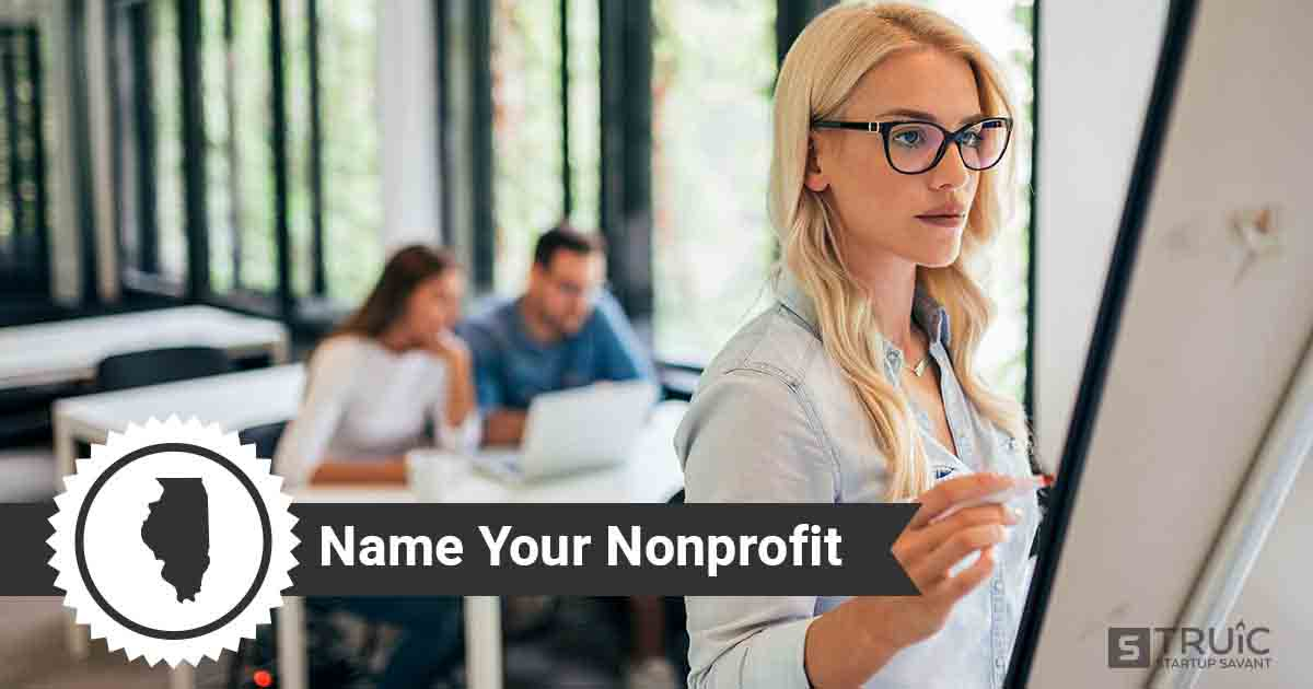 Trio of nonprofit owners looking at potential business names on whiteboard and laptop.