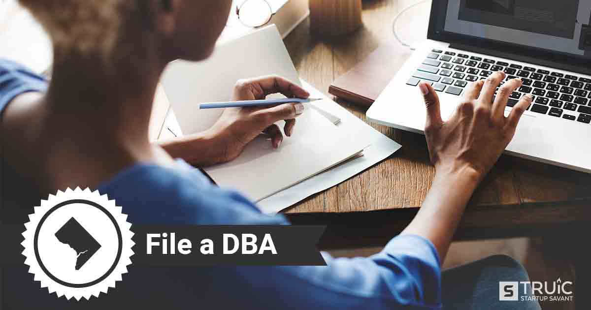 Image of a man looking up how to file a DBA in DC