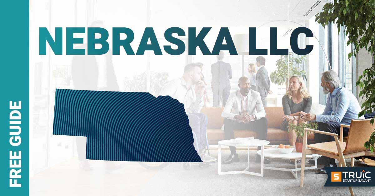 Woman sitting at her desk using her laptop to start a L L C in Nebraska.