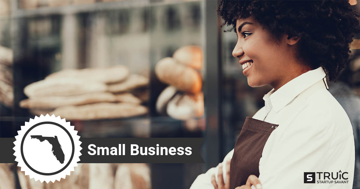 An outline of Florida and woman with her arms crossed, smiling in front of her small business.