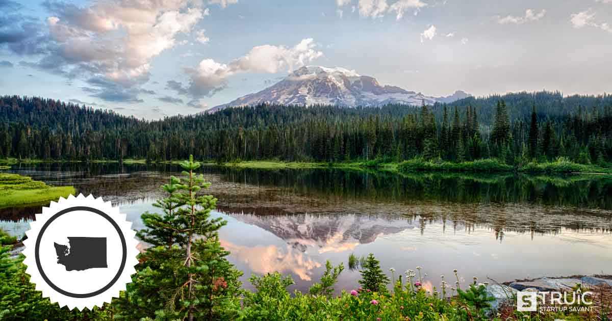 A beautiful lake in Washington with a distant mountain reflected in the water.