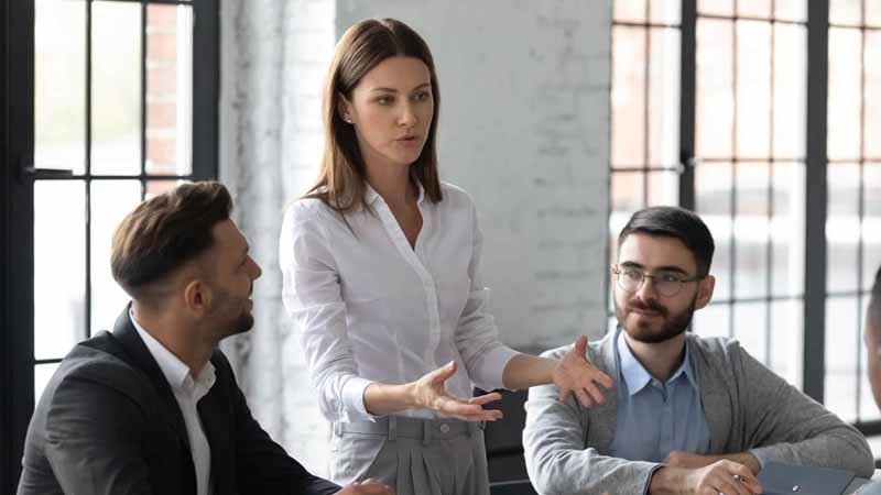 A woman speaking in a business meeting.