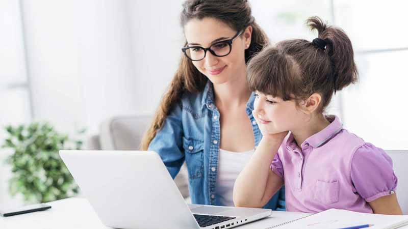 A parent and chid using a laptop together.