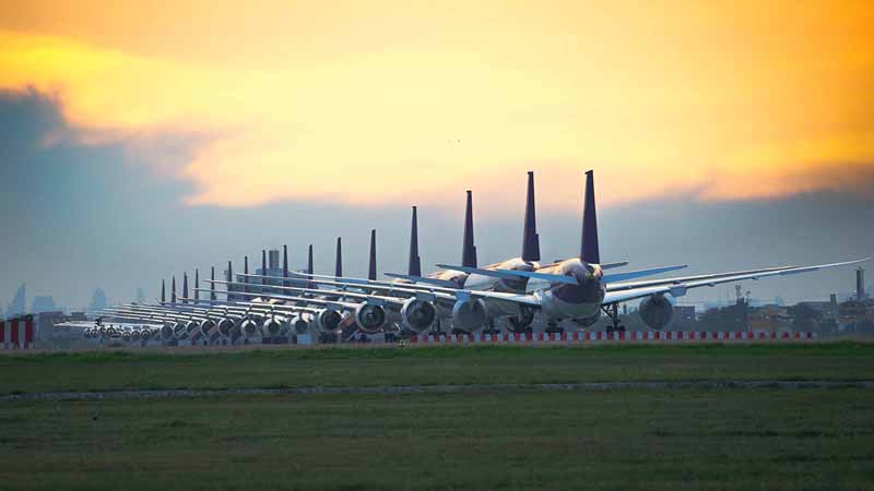 Row of airplanes at an airport.