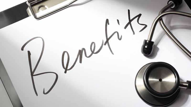 """Stethoscope and medical clipboard with """"benefits"""" written on the paper."""