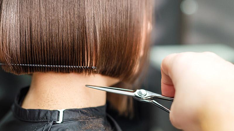 A person receiving a haircut.