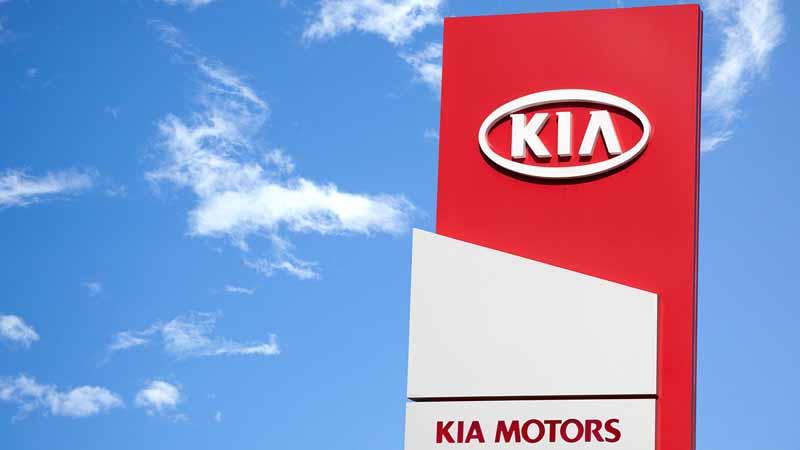 Kia Motors dealership sign.