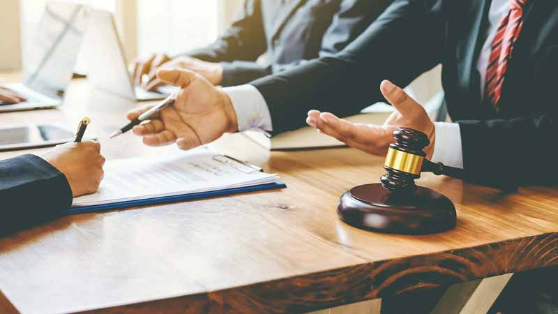 Lawyers disputing legal matters about business law in an office.