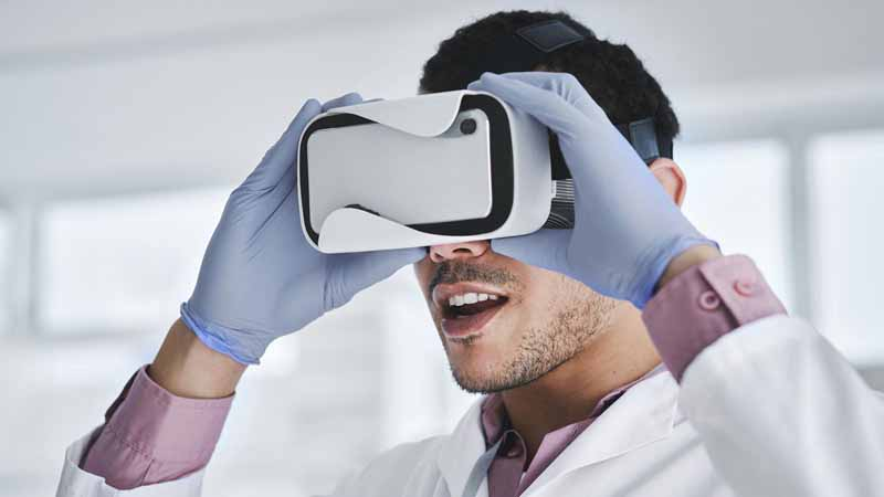 A scientist using a VR headset.