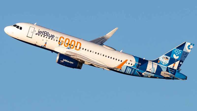 JetBlue airplane taking flight.