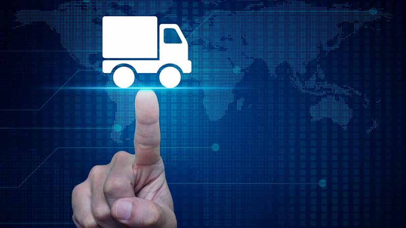 Hand pushing a delivery truck button against a digital map