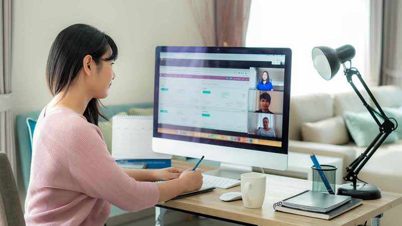Woman participating in a video conference.