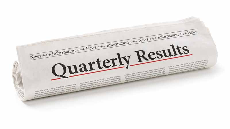 A rolled-up newspaper with the headline 'Quarterly Results.'