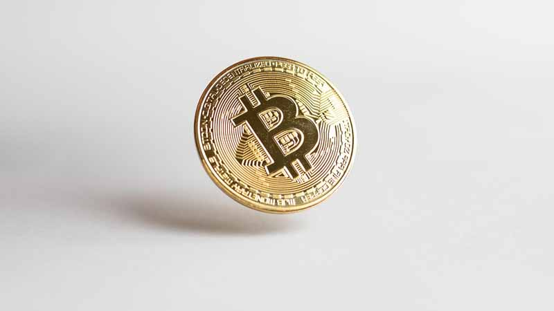 A bitcoin floating in midair.