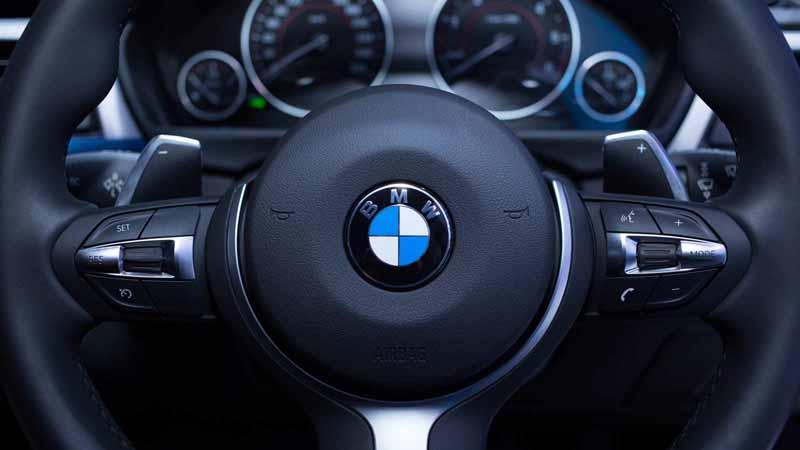 Closeup of a BMW steering wheel.
