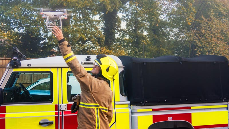 Firefighter using a drone.