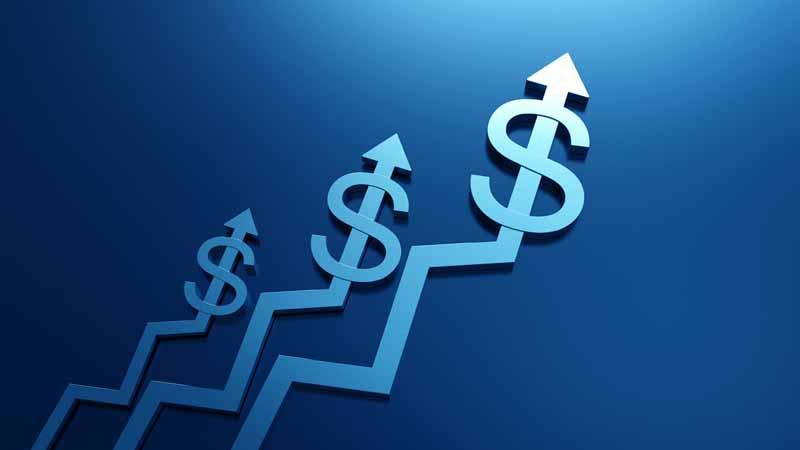 Dollar symbols on a growth chart.