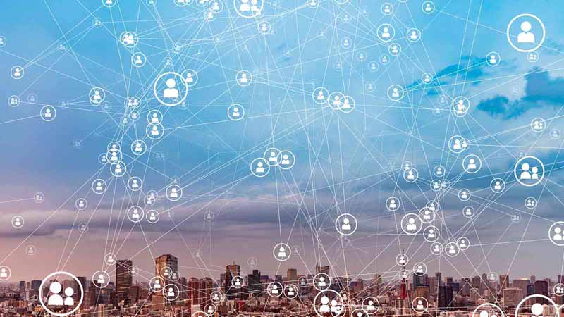 Abstract of a social media web against a city skyline