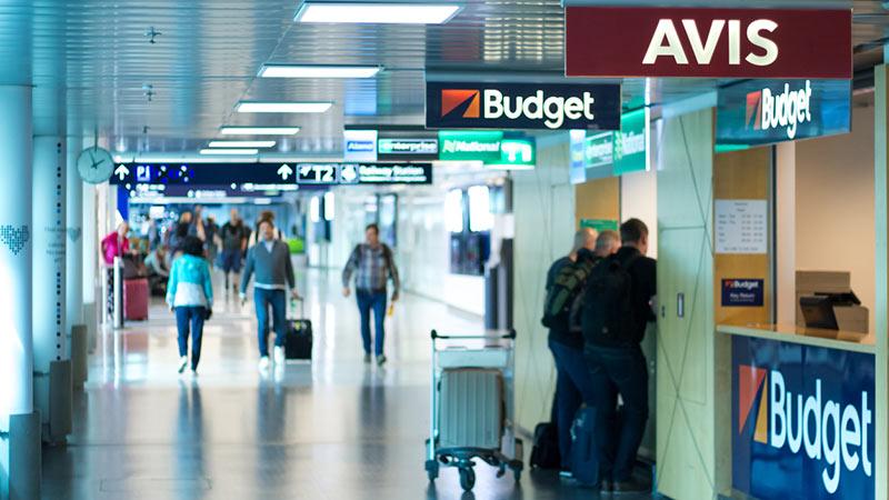 Row of car rental agencies at Helsinki airport.