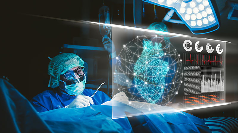 A surgeon looking at a heart on a futuristic interface.