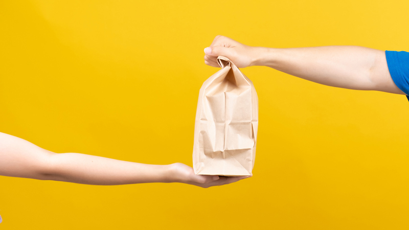 A food delivery exchanging hands.