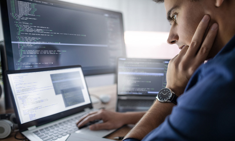 Developer working on computer.
