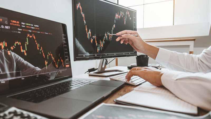 An entrepreneur analyzing a stock market chart.