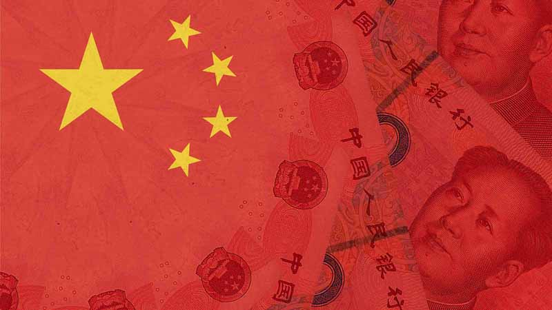 The Chinese flag over yuan banknotes.