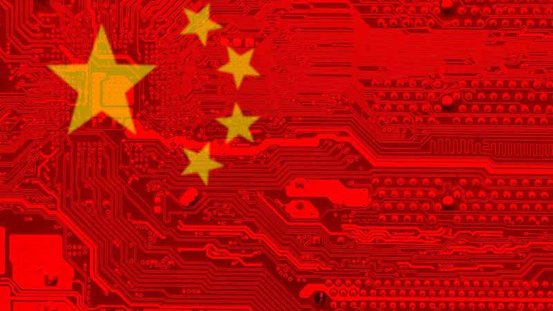 Computer board overlaid with Chinese flag.