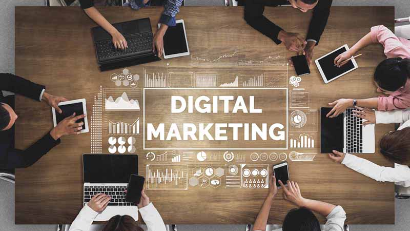 """""""Digital Marketing"""" written on a conference table."""