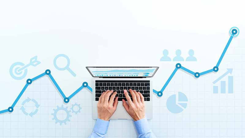 Person working on computer with analytics graphics.