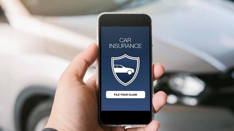 A car insurance logo on a smartphone.
