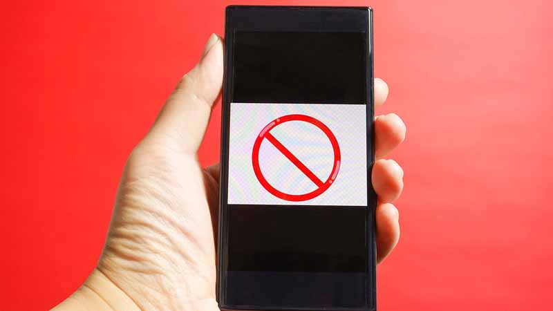 A smartphone showing a red prohibition sign.