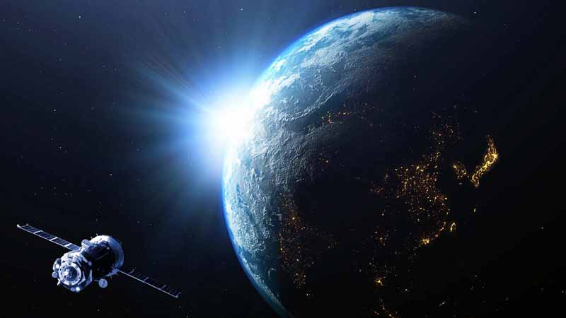 A satellite orbiting Earth in space.