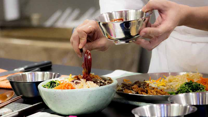 Chef preparing food for customer.
