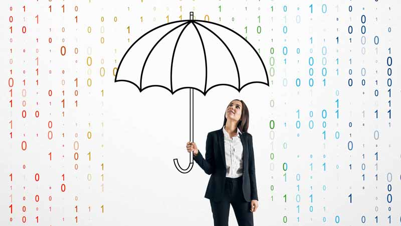 A businesswoman protecting herself from binary code rain with an umbrella.