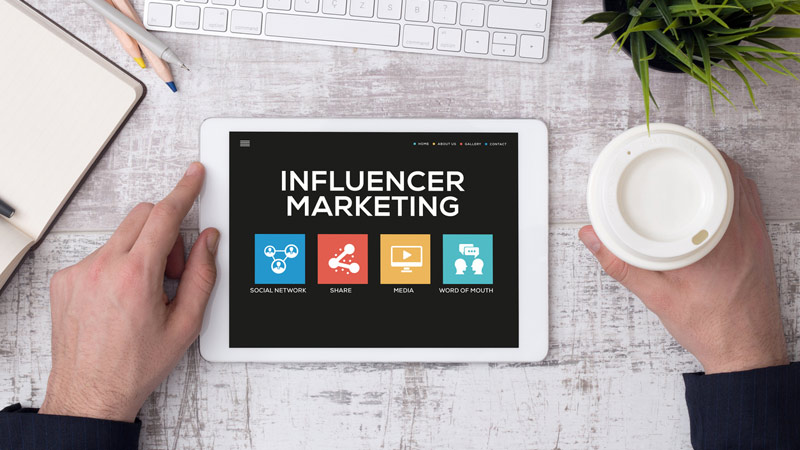 Tablet with Influencer marketing concept on the screen.