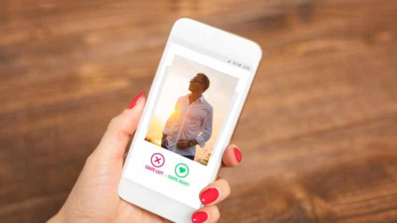 Person using a dating app on a smartphone.