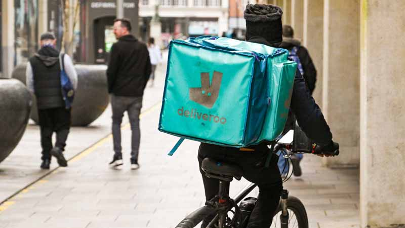 A Deliveroo courier on a bicycle.