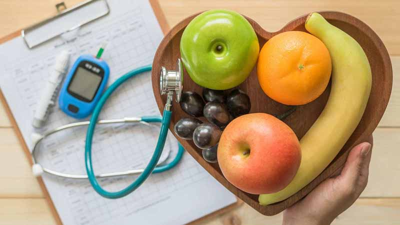 Healthy foods, weights, a stethoscope, and a blood pressure monitor.