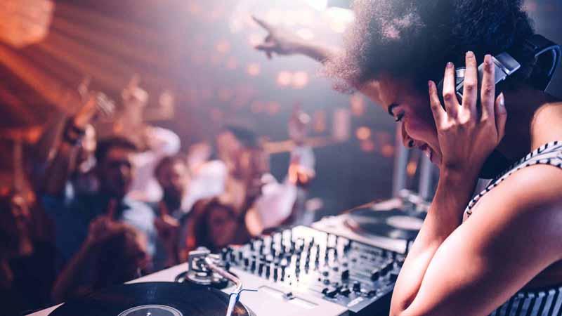 A DJ playing music at a nightclub.