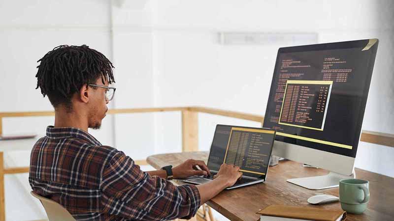 Computer programmer writing code.
