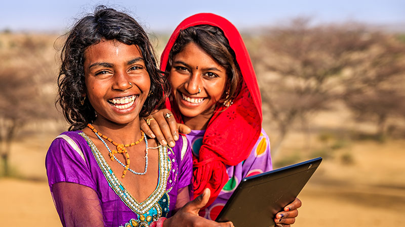 Two Indian women using a tablet.