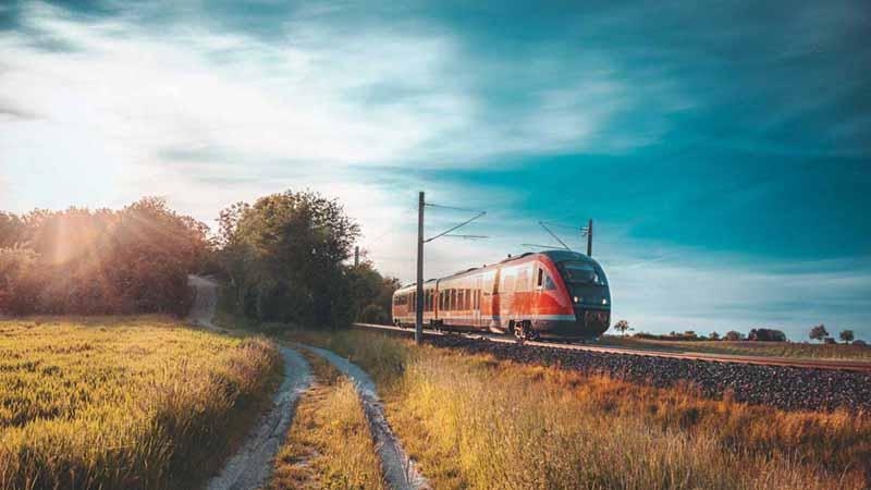 A train moving through a rural area.