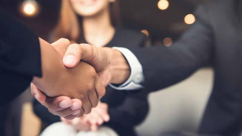 Two entrepreneurs shaking hands.