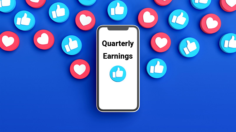 """Phone that says, """"Quarterly Earnings"""" with Facebook like and love icons."""