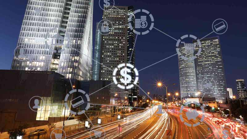 City at night with finance graphic overlays.