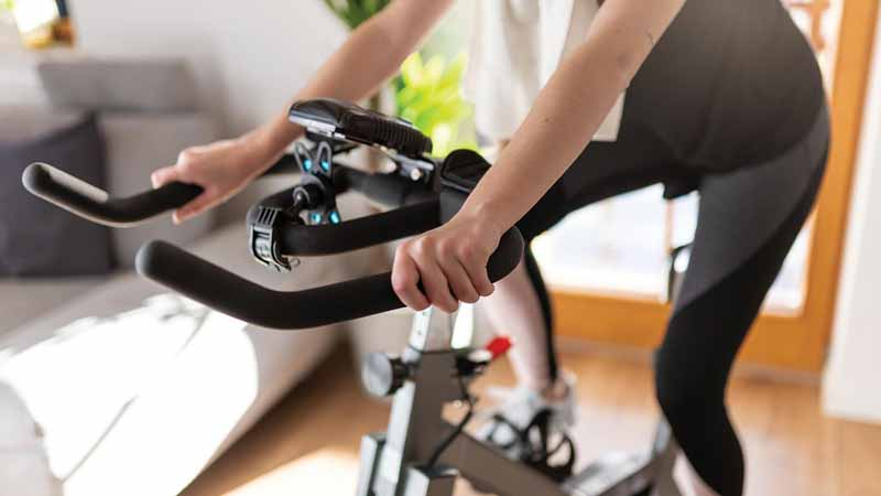 Woman using a spin machine at home.
