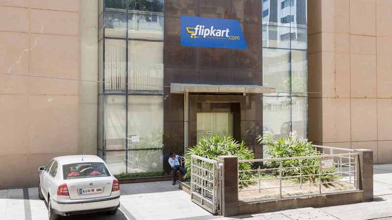 A man sits outside an office of Flipkart Online Services.