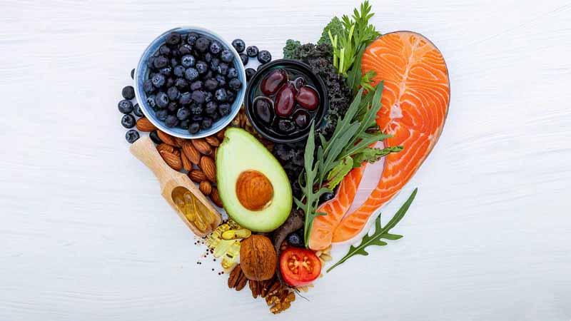 Healthy foods arranged in a heart shape.